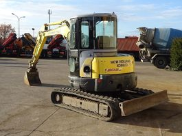 rupsgraafmachine New Holland E 50.2 SR 2009