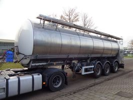 tankoplegger Magyar RVS/INOX Isolated tank - pump - 2x hydr steering axles - Lift axle 2002